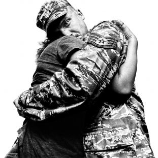 Returning Airman with his loved one